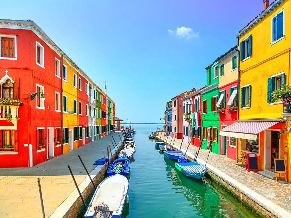 Street of colorful houses at a canal street. Dispersants and wetting agents are key additives to produce high quality colorants with good stability and color acceptance.